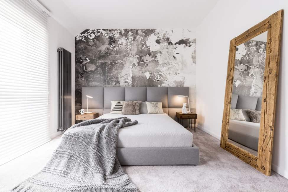 Los tonos grises se mezclan en perfecta armonia con el blanco y la madera